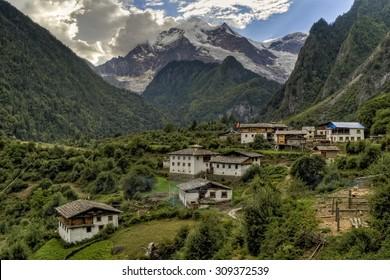 Houses below Meili mountain in Yubeng, Yunnan, China