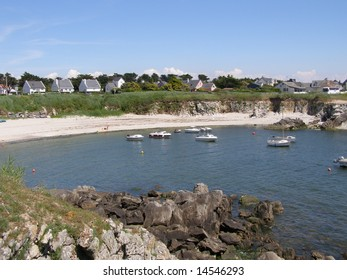 Houses and boats on atlantic ocean french coast in Brittany
