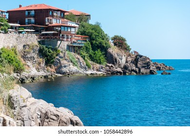 Houses, buildings and remains of the old fortress wall of the ancient seaside town of Sozopol. Bulgaria.