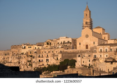 Houses built into the rock with cathedral at the top of the hill, in the cave city of Matera (Sassi di Matera), Basilicata Italy. Matera has been designated European Capital of Culture for 2019.