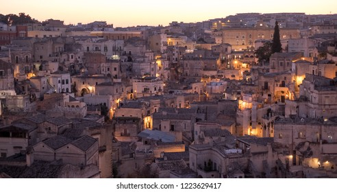 Houses built into the rock in the cave city of Matera (Sassi di Matera), Basilicata Italy. Photographed in twillight. Matera has been designated European Capital of Culture for 2019.