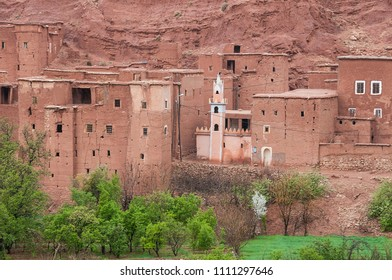 Houses built with mud and mosque minaret in mountain village in southern Morocco