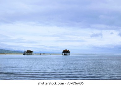 Houses built as a shelter in the middle of the sandbar in Manjuyod, Bais City, Philippines. When its high tide, the sandbar disappears and the houses serves as the makeshift shelter for the tourists.