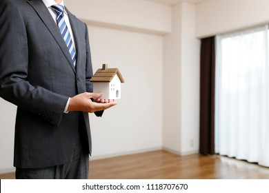 Houses and businessmen