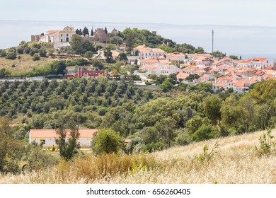 Houses, church and castle in Santiago do Cacem, Alentejo, Portugal