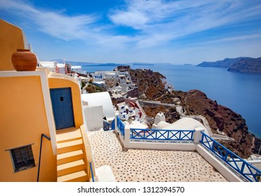 Houses of different colours in Ia town in Santorini, Greece