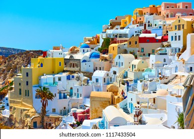 Houses of different colours in Oia, Santorini, Greece