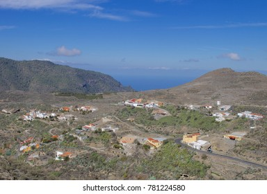 Houses dot the hillside 4,000 ft above sea level in the mountains beneath the town of Artenara, Gran Canaria (Spain).