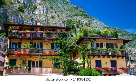 houses with flowers on a street of Limone sul Garda, Lake Garda, Italy