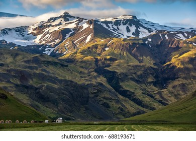 Houses at the foot of the eyjafjallajokull volcano at sunset in Iceland