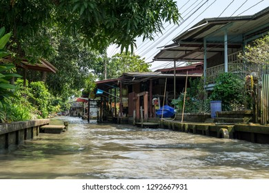 Houses and homes nearby the canal water in Damnoen Saduak Floating market, Thailand
