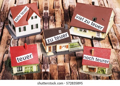 Houses with labels that symbolize overpricing.