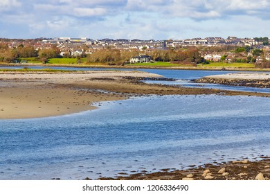 Houses, lake and ocean in Silverstrand Beach, Galway, Ireland
