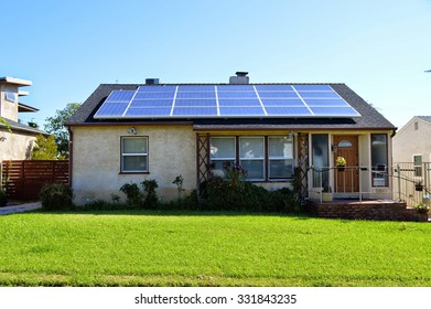 Houses in Los Angeles with solar panels on a roof. California.