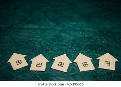 Houses made of cardboard on a green background