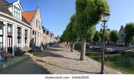 Houses next to a canal in Sloten, Friesland The Netherlands