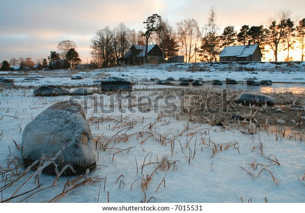Houses next to icy meadow, Europe, Baltic states, Latvia