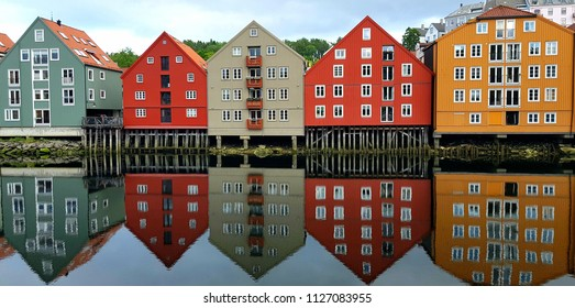 Houses in Norwey at the sunset reflected on the water