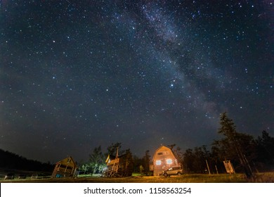 houses on the background of the starry sky, the milky way, night