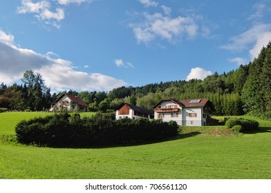 Houses on the green hill in Austria