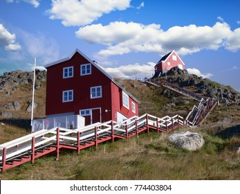 Houses on a hilltop in the township of Qaqortoq, Greenland