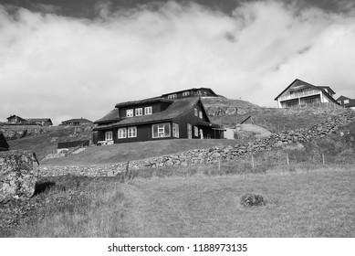 Houses on hilly terrain in Torshavn, Denmark. Eco friendly buildings on natural landscape on cloudy sky. Architecture and design. Ecology and environment. Summer vacation in countryside.