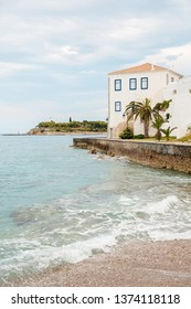 houses on the island of Hydra, Greece, Ionian Sea, Greek island Spetses, the embankment of the old town with beautiful houses on the sea