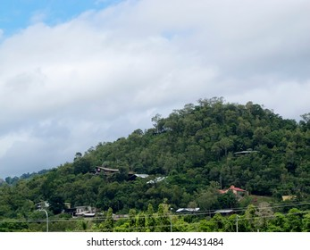Houses on the rainforest hill near Smithfield in Tropical North Queensland, Australia