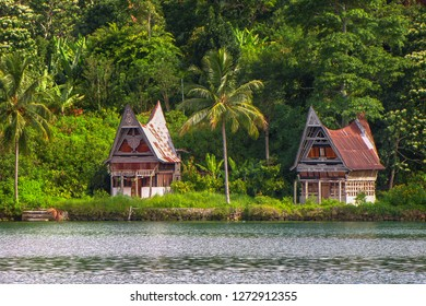 Houses on the shore of Samosir island in the middle of the volcanic lake Toba, Sumatra, Indonesia