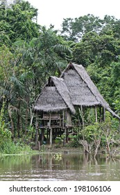 Houses on stilts rise above Amazon River Basin near Iquitos, Peru