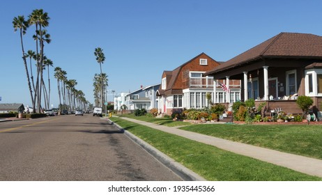 Houses on suburban street in California USA, Oceanside. Generic buildings in residential district near Los Angeles. Real estate property exterior. Tropical gardens, palms near typical american homes.