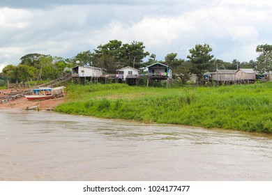 Houses on wooden stilts to allow flooding  along the Amazon River in the province of Amazonas in Brazil, South America