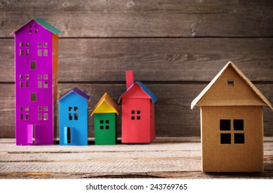 houses from the paper on wooden background