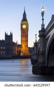 Houses of Parliament and Big Ben with river Thames and Bridge at sunset in London, United Kingdom