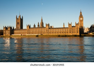 Houses of parliament and Big Ben at sunrise against a clear blue sky