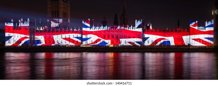 Houses of Parliament illuminated with Union Jack Flag
