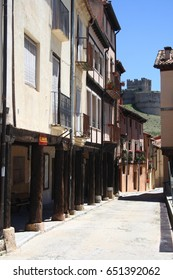 houses, Popular architecture in the towns of Berlanga de Duero, Soria, Spain,With the castle in the background in the mountains