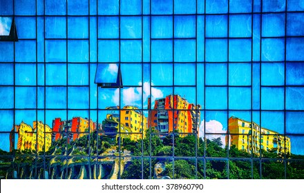 houses reflected in the wall of a skyscraper vintage effect