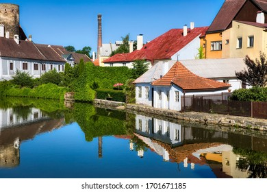 Houses Reflecting in the Vajgar Pond in the Hamersky Potok River at Jindrichuv Hradec in the Czech Republic