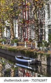 Houses and reflections at the quay side in Gouda in the Netherlands