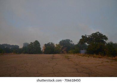The houses of the residential district stand in the smoke of the fire.