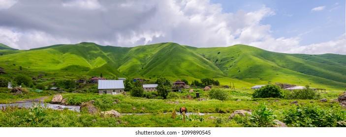 Houses in Roshka village and green mountains around, Georgia