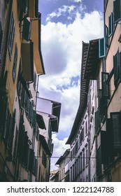 Houses and sky in Italy Italian traditional buildings with windows and shutters jalousie and purple cloudy clear sky