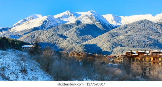 houses and snow mountains landscape sunrise panorama in bulgarian ski resort Bansko, Bulgaria