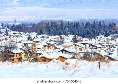 Houses with snow roofs panorama banner of bulgarian ski resort Bansko, Bulgaria