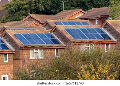 Houses with solar panels on top of roof