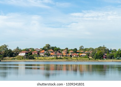 Houses and their reflection on the water at Parramatta River. Sydney, Australia.