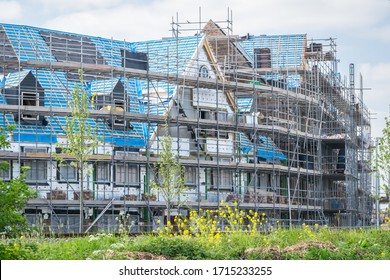 """Houses under construction in new neighborhood """"Triangel"""" in the town of Waddinxveen, close to the cities of Gouda and Rotterdam, Holland."""