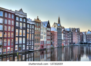 Houses at the waterside of the Damrak in Amsterdam, the Netherlands. HDR