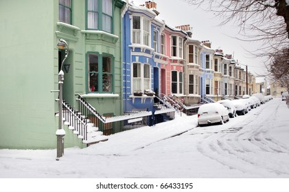 houses in winter snow, victorian or edwardian english architecture in Brighton. Typical street with bright exterior